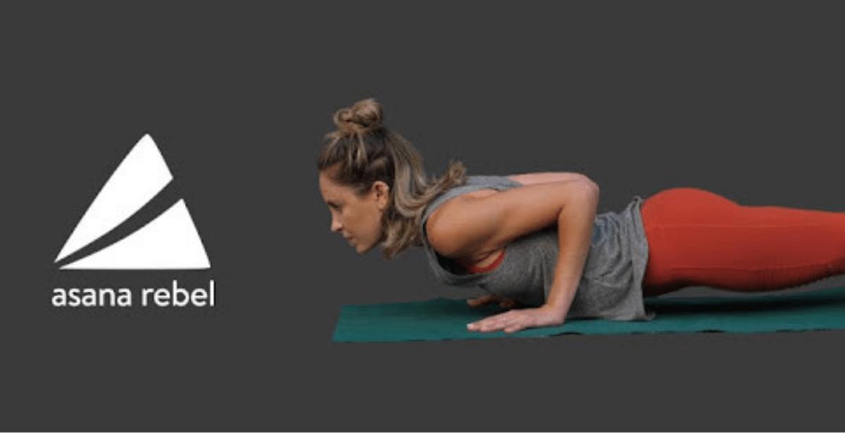 woman doing yoga beside the asana rebel